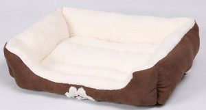 One of the best bolster beds for small dogs is the HappyCare Textiles