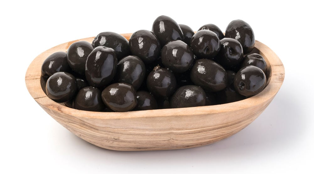A bowl full with black olives